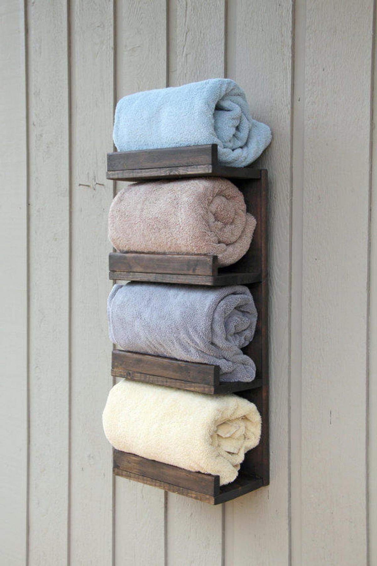 A rustic towel organizer