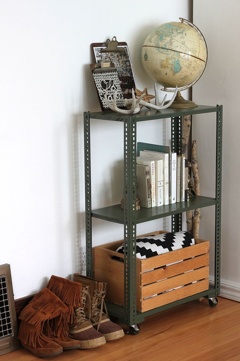 A wheeled shelving unit made with plated slotted angles