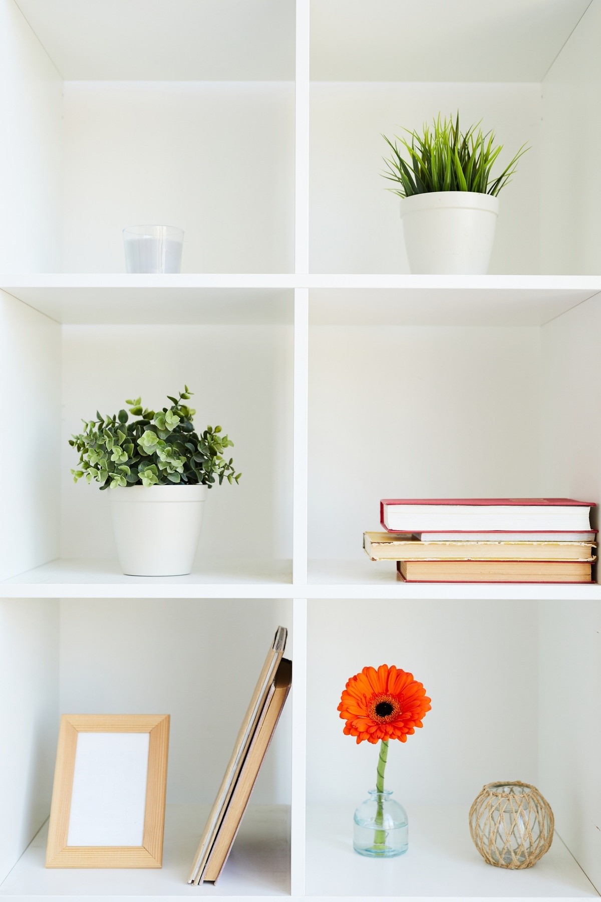 Add Artwork to Your Shelves 10 DIY Ways to Decorate Your Bookcase