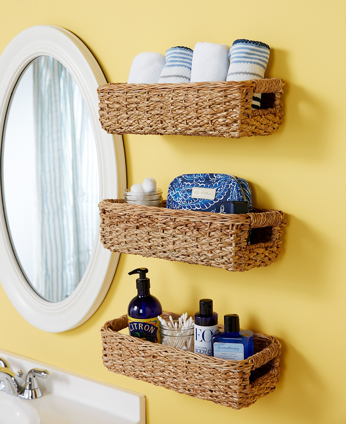 Turn an old basket into a towel organizer